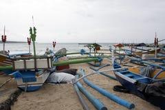 Traditional fishing boats at Jimbaran Beach. Bali, Indonesia Stock Photos