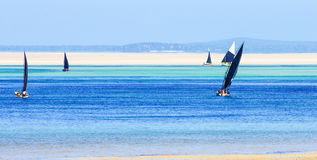 Traditional fishing boats with low tide. In Mozambique coastline Royalty Free Stock Photography