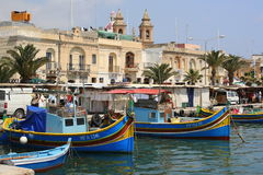 Traditional fishing boats in Marsaxlokk. Traditional painted fishing vessels or luzzus in Marsaxlokk harbour, Malta Royalty Free Stock Image