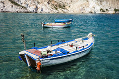 Traditional fishing boats in Milos island Greece Stock Images