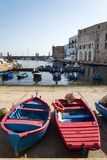 Traditional fishing boats in Monopoli port, Apulia, Bari province, Italy. Traditional red and blue fishing boats in Monopoli port near Castle of Carlo V, Apulia stock photo