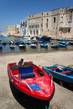 Traditional fishing boats in Monopoli port, Apulia, Bari province, Italy. Traditional red and blue fishing boats in Monopoli port near Castle of Carlo V, Apulia royalty free stock photography
