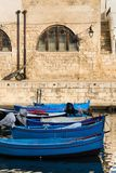 Traditional fishing boats in Monopoli port, Apulia, Bari province, Italy. Traditional red and blue fishing boats in Monopoli port near Castle of Carlo V, Apulia royalty free stock photo