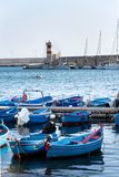 Traditional fishing boats in Monopoli port, Apulia, Bari province, Italy. Traditional red and blue fishing boats in Monopoli port near Castle of Carlo V, Apulia royalty free stock image