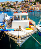 Traditional fishing boats in Nanou beach in Symi island in Greece Royalty Free Stock Photo