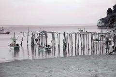 Traditional fishing boats near wooden bridge. Stock Image