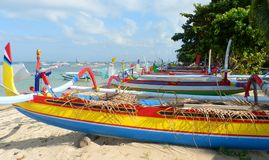 Traditional fishing boats on Sanur Beach. Colorful traditional fishing boats on Sanur Beach, Bali Stock Photo