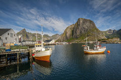 Traditional fishing boats in scenic harbor on Lofoten islands in Norway Stock Photo