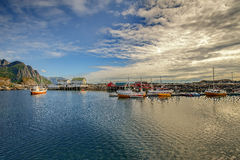 Traditional fishing boats in scenic harbor on Lofoten islands in Norway Stock Photos