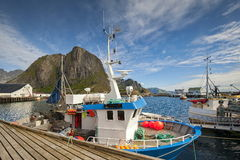 Traditional fishing boats in scenic harbor on Lofoten islands in Norway Royalty Free Stock Photos