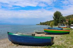 Traditional fishing boats on the shore of the lake Ohrid royalty free stock photo
