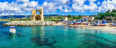 Traditional Briatico village,view with old tower,Calabria. Traditional fishing Briatico village,view with colorful boats and old tower,Calabria,itally royalty free stock photos