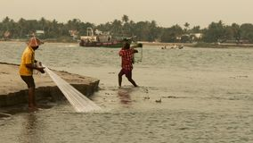 Traditional fishing in cochin, south india stock footage