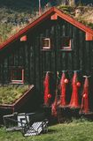 Traditional fishing house with grass on roof and mountains landscape on background. In Norway Royalty Free Stock Image