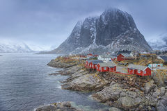 Traditional Fishing Hut Village in Hamnoy Mountain Peak in Lofoten Islands Stock Photo