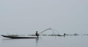 Woman on canoe Fishing in lake  Stock Image