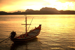 Traditional fishing long tailed boat in Koh Phitak island. Stock Photos
