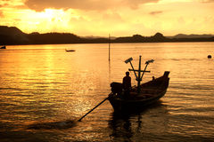 Traditional fishing long tailed boat in Koh Phitak island. Royalty Free Stock Image