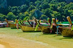 Traditional fishing longtail boats on the tropical beach, Krabi, Thailand Royalty Free Stock Images