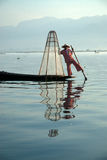 Traditional fishing by net in Inle Lake,Myanmar. Royalty Free Stock Photos