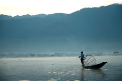 Traditional fishing by net in Inle Lake,Myanmar. Stock Images