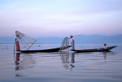 Traditional fishing by net in Inle Lake,Myanmar. Stock Photo