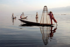 Traditional fishing by net in Inle Lake,Myanmar. Stock Photos
