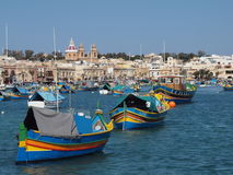 Traditional Fishing Village Harbour, Malta. View across the crowded waters of the traditional fishing village of Marsalokk in Malta. Colourful boats and Royalty Free Stock Photography
