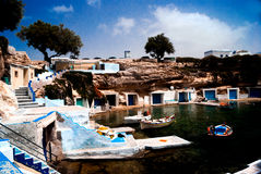 Traditional fishing village on Milos island Stock Photos