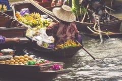 Traditional floating market in Damnoen Saduak near Bangkok Stock Photos