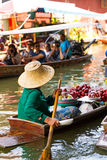 Traditional floating market in Damnoen Saduak near Bangkok. Stock Images