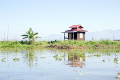 Traditional floating village house in Inle Lake, Myanmar Stock Photo