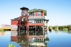 Traditional floating village house in Inle Lake, Myanmar Stock Image