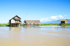 Traditional floating village houses in Inle Lake, Myanmar Stock Photo