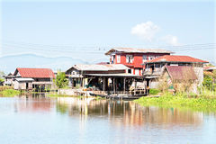 Traditional floating village houses in Inle Lake, Myanmar Stock Image