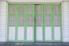 Traditional folding door of The Abidin Mosque in Kuala Terengganu, Malaysia Royalty Free Stock Photos