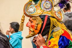 Traditional folk dancer mask & costume, Guatemala. Parramos, Guatemala - December 28, 2016: Traditional folk dancer in mask & costume for Dance of the Moors & royalty free stock images