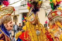 Traditional folk dancers in mask & costume, Guatemala stock photo