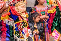 Traditional folk dancers in Spanish conquistador masks & costume royalty free stock images