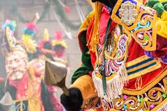 Traditional folk dancers in Spanish conquistador masks & costume stock photography