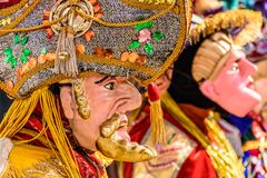 Traditional folk dancers in Spanish conquistador masks & costume royalty free stock photo