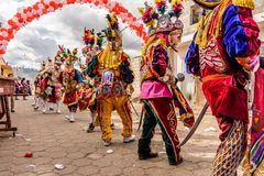 Traditional folk dancers in street, Guatemala Royalty Free Stock Photography