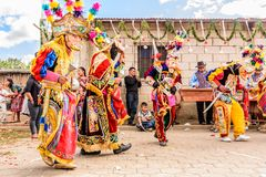 Traditional folk dancers in street, Guatemala Stock Photo