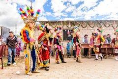 Traditional folk dancers in street, Guatemala royalty free stock photos