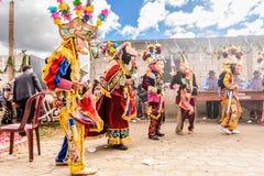 Traditional folk dancers in street, Guatemala stock photography