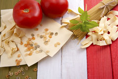 Traditional food on the background of the Italian flag. Stock Photo