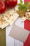 Traditional food on the background of the Italian flag. Stock Images