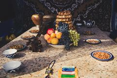 Inside the Yurt. The traditional food in Central Asia with treats, food and old national musical instruments. Inside the Yurt. The middle East. Oriental flavor royalty free stock image