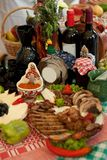 Traditional food and decoration. On plate with red wine in bottle and fruits Stock Photography