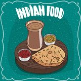 Indian round flatbread with sauces and masala chai Royalty Free Stock Image